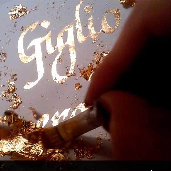 Deianira, calligrafia, cancelleresca-giglio-foglia-oro